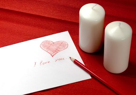 envelope with red heart and two candles on red background Stock Photo - 2426244