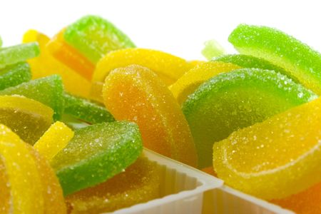 close-up of colourful fruit candies over white photo