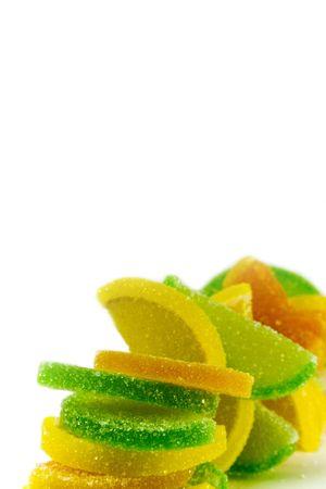colourfu fruit candies over white background photo