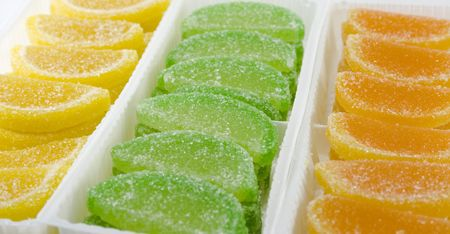 close-up of colourful fruit candies in boxes photo