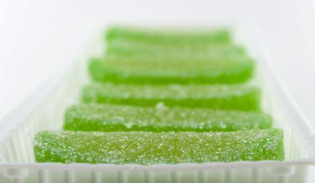 green candies in white box photo