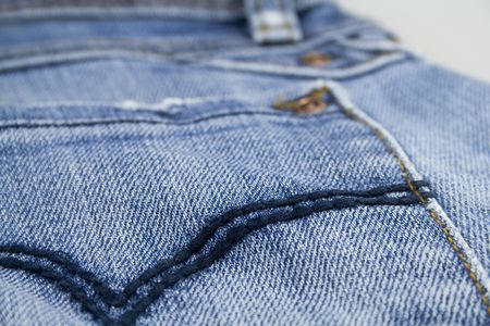 pocket of blue jeans close up photo