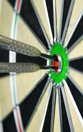 bulls-eye and darts close-up photo