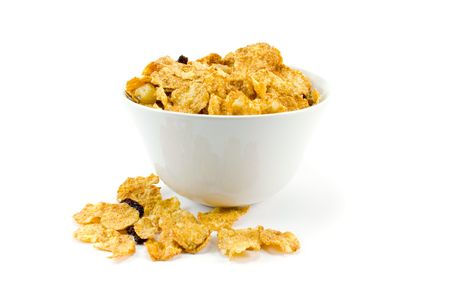 cornflakes in bowl over white background Stock Photo - 2602441