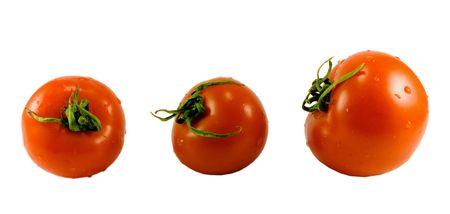 three tomatoes isolated on white background photo