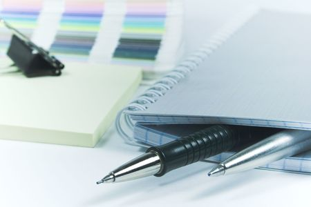 Pens and blank notebook photo