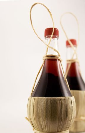 two bottles of red wine photo