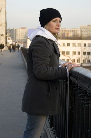 The thoughtful pretty womanl on the bridge photo