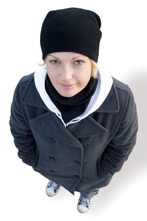 girl in cap, coat and gym shoes on white background photo