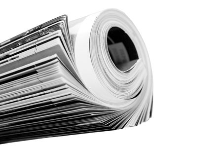 rolled up magazine over white photo