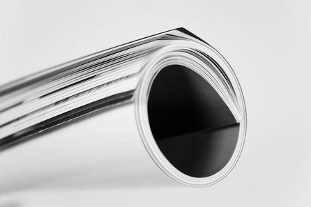 rolled up magazine over white Stock Photo - 3007850