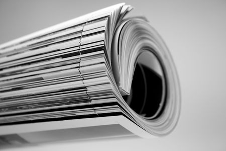 rolled up magazine over white Stock Photo - 3014797