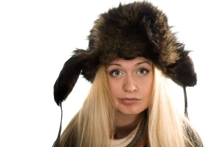 Beautiful girl in fur cap and scarf on white photo
