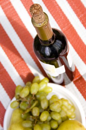 delicious appetizer - red wine and fruits photo