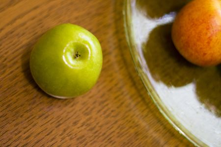 green apple and plate on table  photo