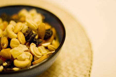 bowl of mixed nuts and dried fruits photo