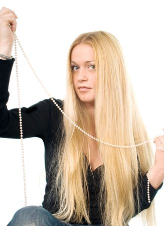 Portrait of the beautiful blond woman with a pearl necklace in her hands photo