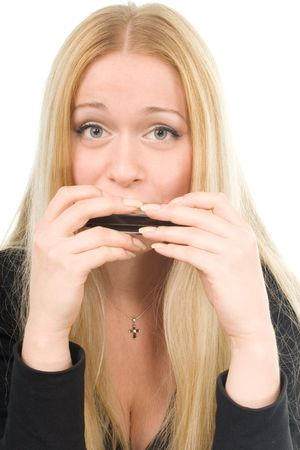 Portrait of the beautiful blond woman with a harmonica photo