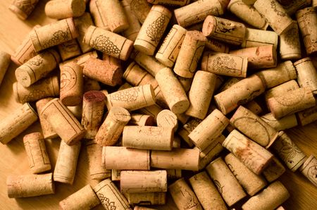 wine corks heap on wooden background photo