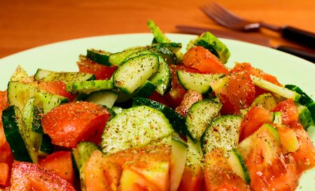 fresh vegetable salad with spices close up photo