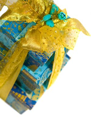 pyramid of blue gift boxes with golden bow on white background photo