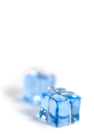 two blue glass cubes with silver ribbon on white background Reklamní fotografie - 3368612