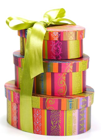 pyramid of colorful gift boxes with green bow on white background Stock Photo - 3373040