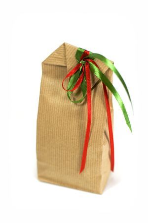 brown gift bag with ribbons isolated on white background photo