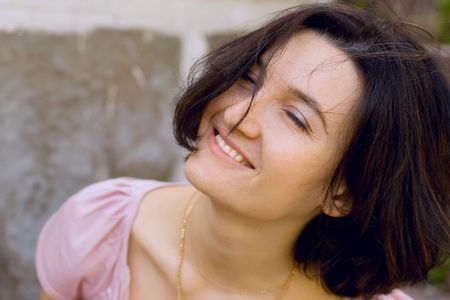 outdoor portrait of happy brunet woman with closed eyes Stock Photo - 3430438