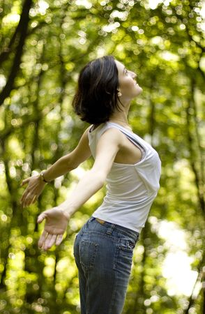 happy woman preparing to fly in a forest photo