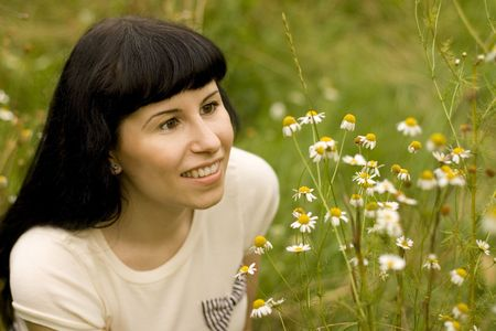 pretty young girl relaxing on a meadow photo