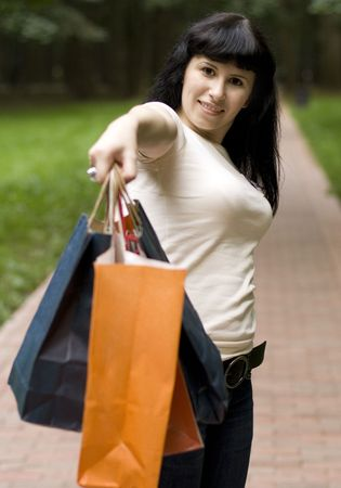 attractive yound girl with shopping bags in her hand photo