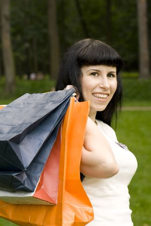 attractive girl holding in hands bags with purchases photo