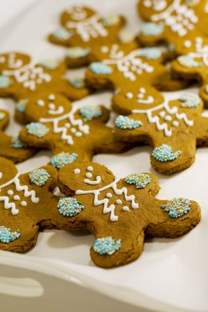 closeup of fresh baked cheerful gingerbread men cookies with decorations photo