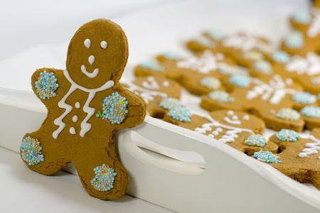 closeup of fresh baked cheerful gingerbread men cookies with decorations Stock Photo - 3467742