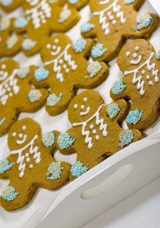 closeup of fresh baked cheerful gingerbread men cookies with decorations Stock Photo - 3467743