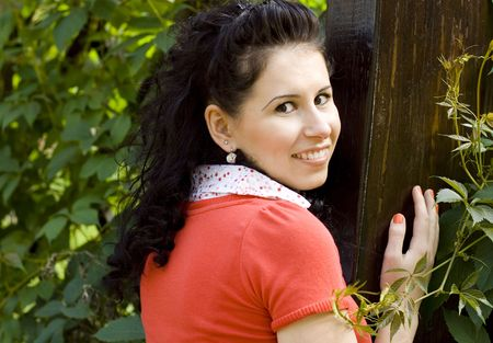 outdoor portrait of pretty young smiling woman in red photo