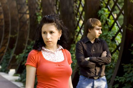 outdoor portrait of unhappy young couple photo