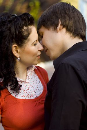 outdoor portrait of young loving couple kissing and hugging each other photo