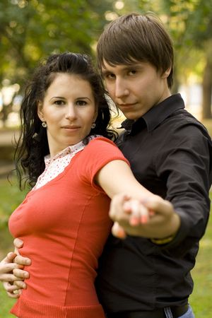 outdoor portrait of young happy attractive couple together photo