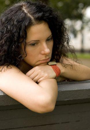 outdoor portrait of unhappy pretty woman photo