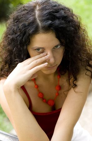 outdoor portrait of unhappy pretty woman in red Stock Photo - 3496295