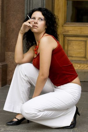 outdoor portrait of brunette with cigarette photo