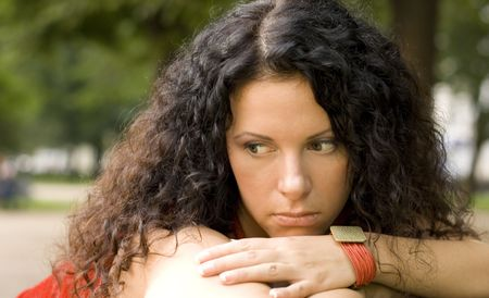 outdoor portrait of unhappy pretty woman Stock Photo - 3496324