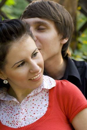 outdoor portrait of young loving couple kissing photo