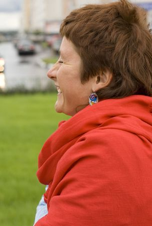 outdoor portrait of laughing redhead woman photo
