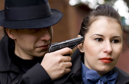 man threatens the woman with a pistol Stock Photo - 3574997