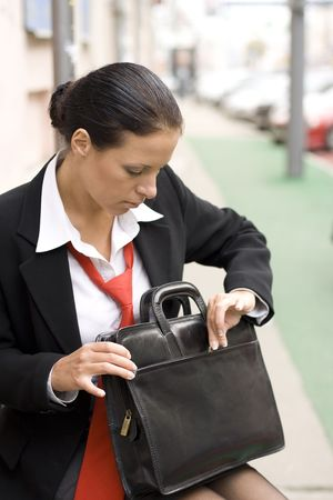 outdoor portrait of businesswoman with briefcase photo
