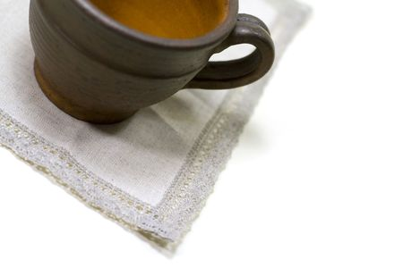 musetti: empty coffee cup and linen napkin on white background Stock Photo