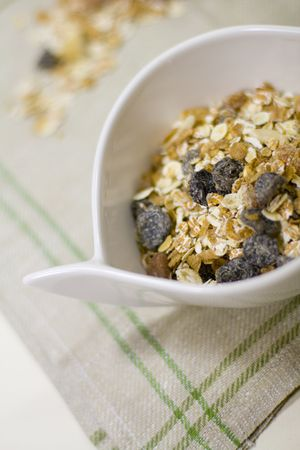 musli: bowl full of musli and bottle of milk - healthy breakfast